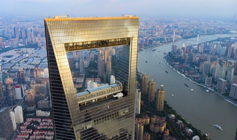 CHINA, SHANGHAI - AUGUST 4, 2018. View To Huangpu River And Cargo Shipping Boats And Shanghai World Financial Center. Window Of Shanghai Skyline And Opener.