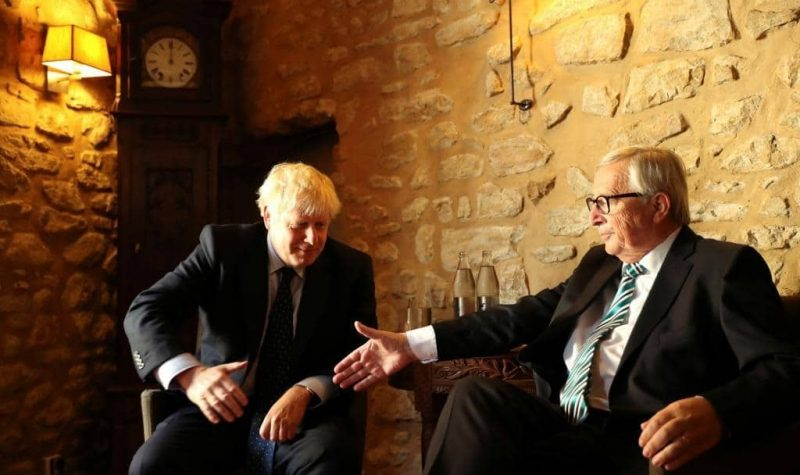 European Commission President Jean-Claude Juncker reaches out to shakes hands with British Prime Minister Boris Johnson prior to a meeting at a restaurant in Luxembourg September 16, 2019. Francisco Seco/Pool via REUTERS